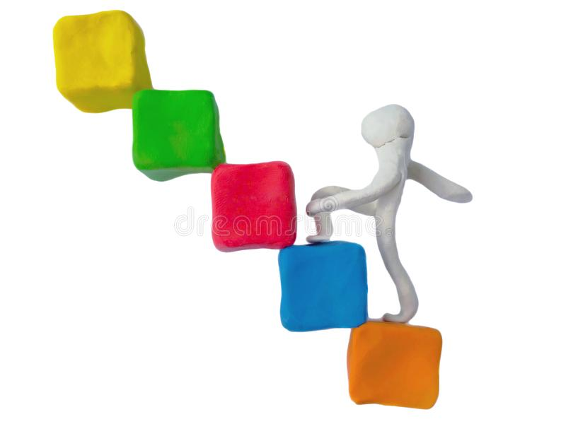Person step up plasticine clay, beginner business, reach the goal royalty free stock images