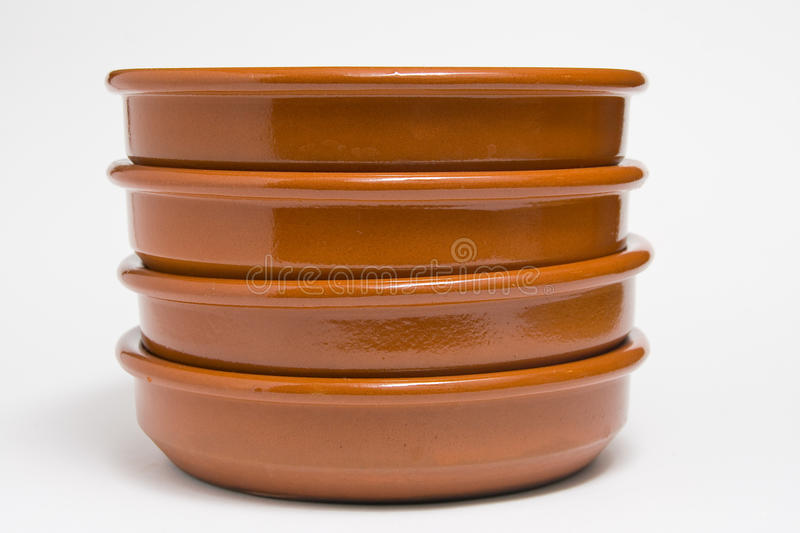 Clay plates. Four plates of clay placed in column stock photo