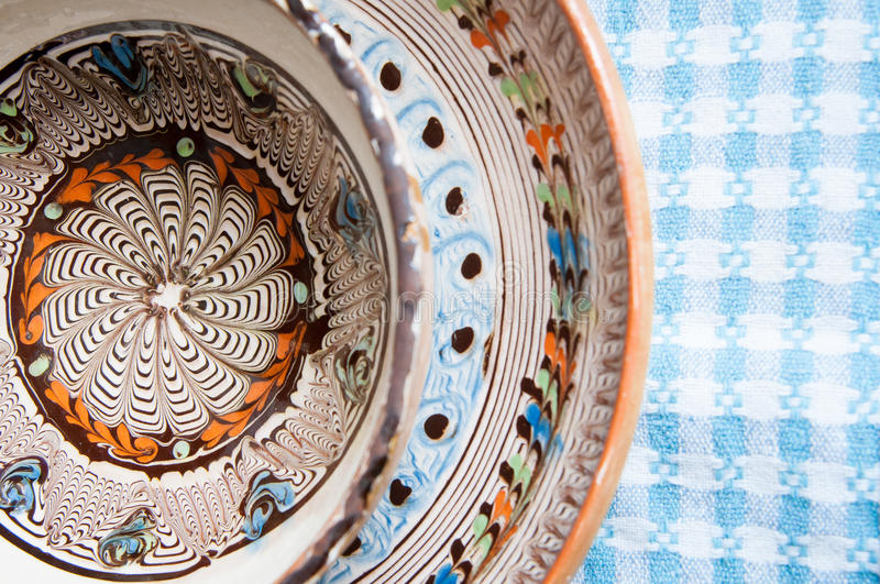 Clay plates. Handmade clay plates pile with painted traditional romanian motifs stock photos