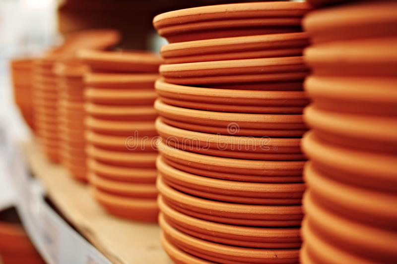 Clay plates stack. Clay plates are ready for sale in the workshop royalty free stock photo