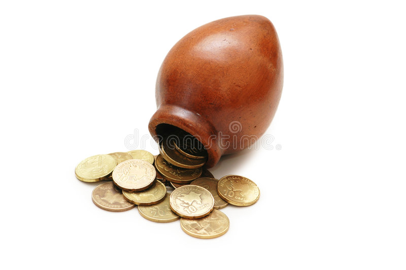 Clay pot and coins isolated. On white royalty free stock photo