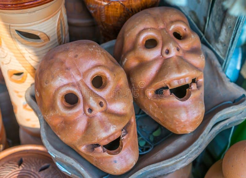 Clay pot masks royalty free stock photo