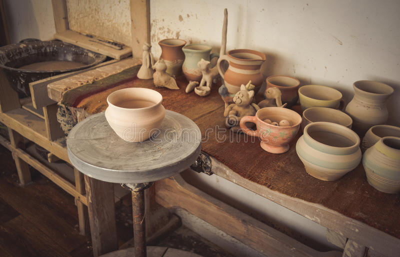 Clay pot on a potter`s wheel. Close-up. Copy spase stock images