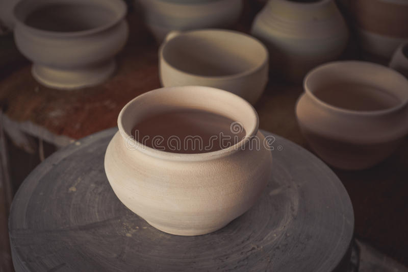 Clay pot on a potter`s wheel. Close-up. Copy spase stock photo