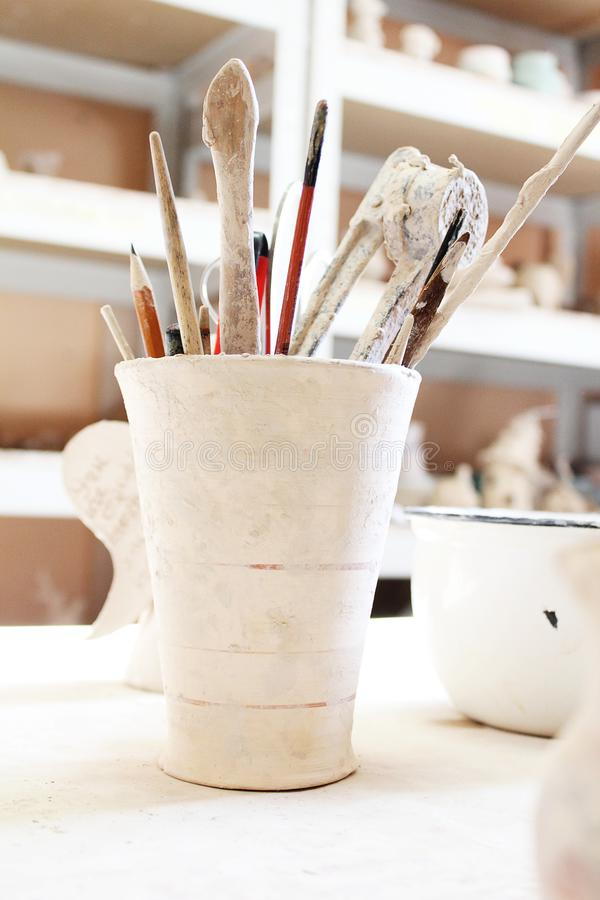 Clay pot pottery tools working place royalty free stock photos