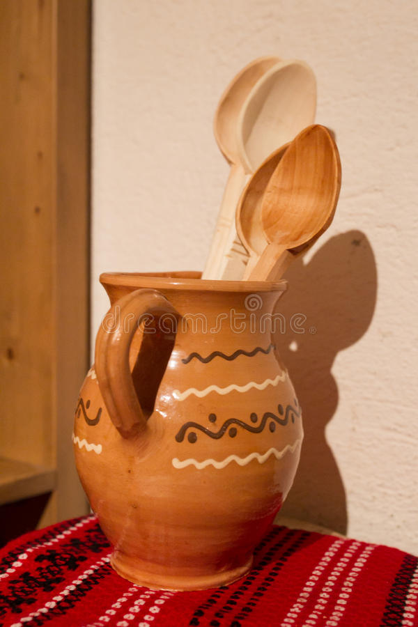 Clay pot with wooden spoon stock photos