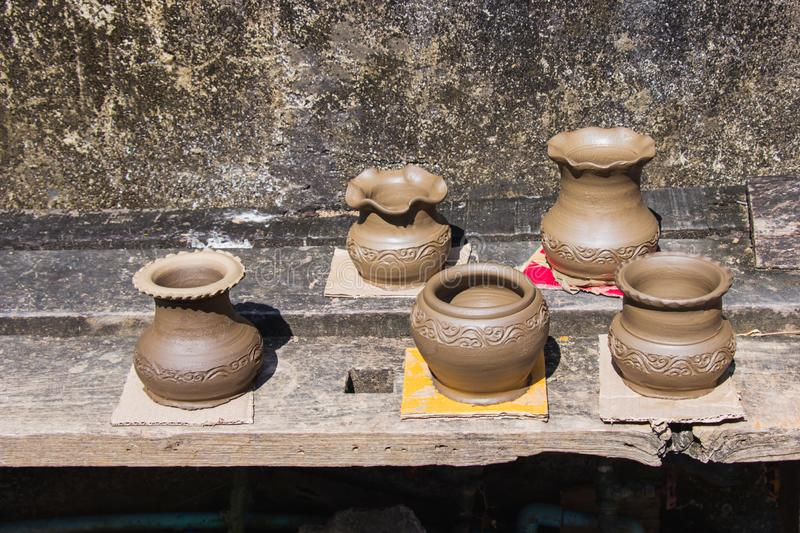 Clay pots made by hand of Thai traditional pottery jar placed in the outdoor to the sun of villages at Ko Kret. stock image