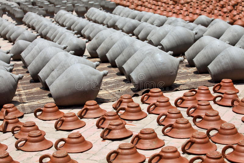 Clay pots and plates. Drying on the street of Bhaktapur, Kathmandu Valley, Nepal royalty free stock photos