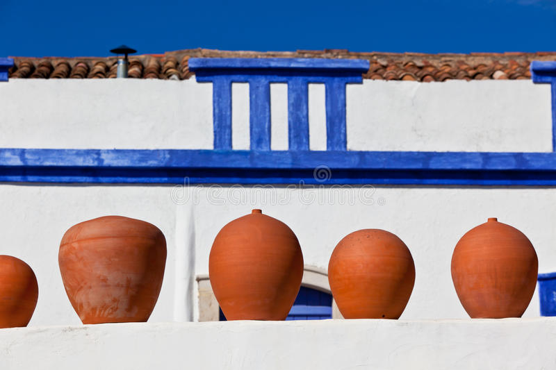 Download Clay Pots Stand On White Pottery Wall In Portugal Stock Image - Image of horizontal, brown: 30934287