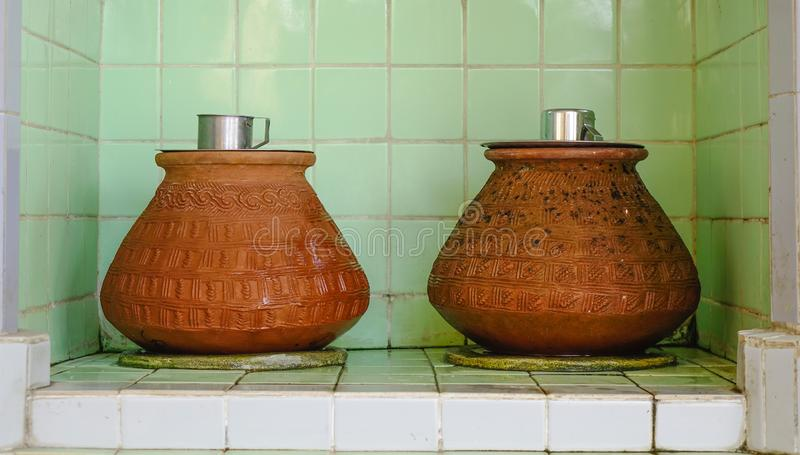 Clay pots with water for drinking at a temple. In Yangon, Myanmar royalty free stock photography