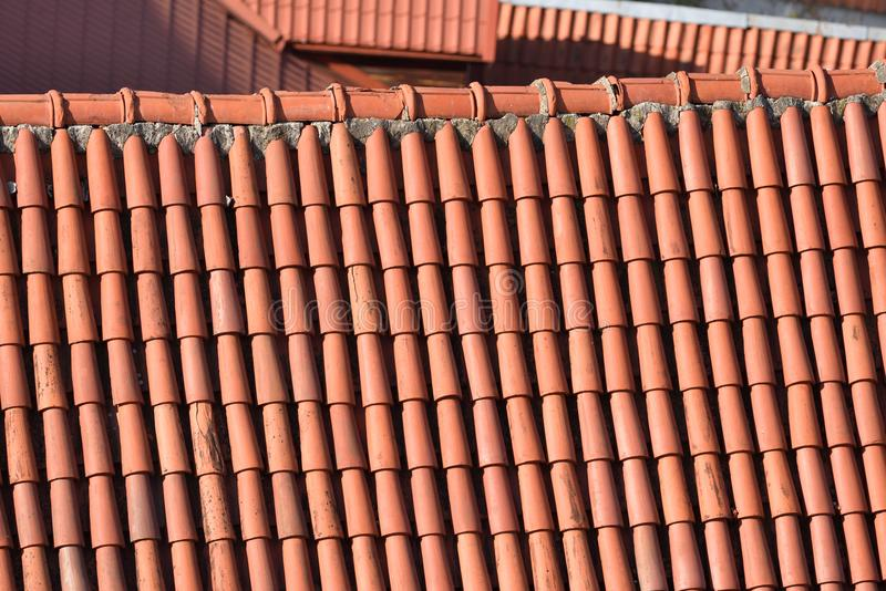 Clay Roof Tiles. Detail of a house roof made with red clay tiles royalty free stock photo