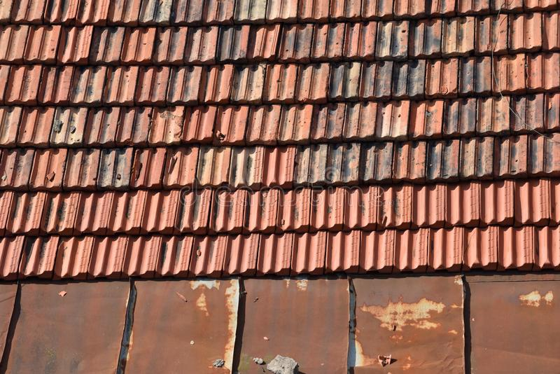 Clay Roof Tiles. Detail of a house roof made with red clay tiles stock image