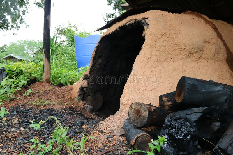 Clay stove for burning wood. To make charcoal in Thailand royalty free stock photo