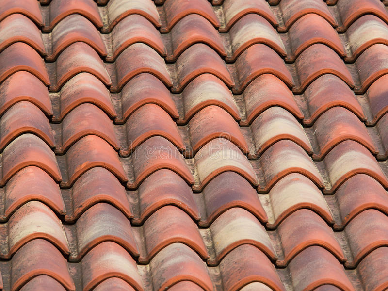 Clay (terracotta) tiles on the roof of a country house. Pattern created by clay (terracotta) tiles on the roof of a country house in Italy royalty free stock photo