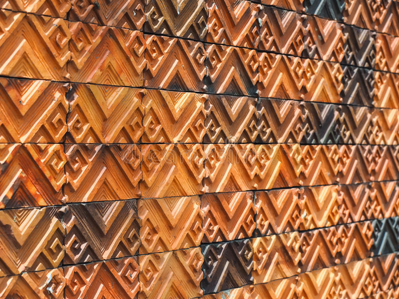 Clay Tiles. The brown clay tiles wall in the house royalty free stock photo