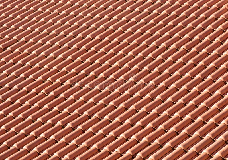 Clay tiles on a roof. Clay ceramic tiles on a roof royalty free stock photos