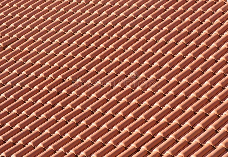 Clay tiles on a roof. Clay ceramic tiles on a roof stock photos