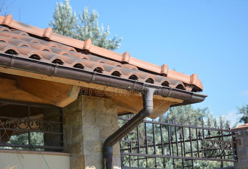 Clay tiles roof with plastic roof guter. Guttering photo. Clay tiles roof with plastic roof guter pipeline. Guttering photo stock images
