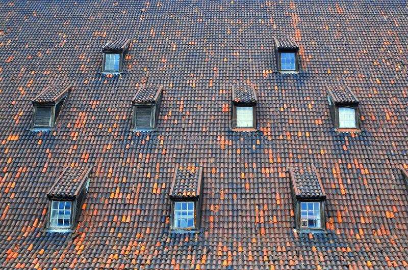 Clay tiles roof and windows. Clay tiles roof and roof windows royalty free stock photography