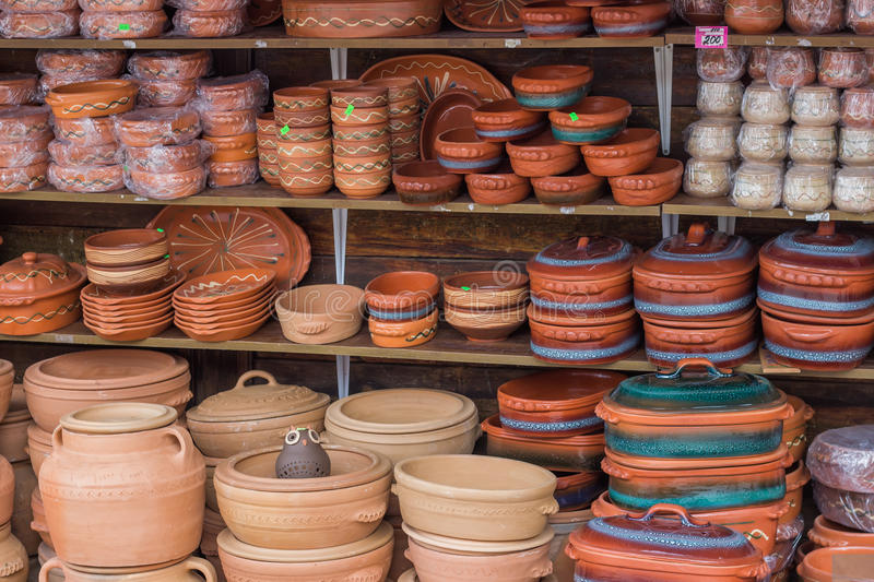 Clay ware for sale, clay cookware on sale. The clay holds nutrients and keeps your food moist. It is slow cooking, very safe and natural stock photography