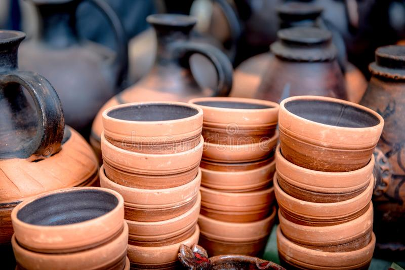 Clay ware . Clay ware for sale clay cookware on sale. The clay holds nutrients and keeps your food moist stock photos
