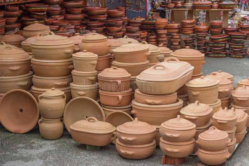 Clay ware for sale 2. Clay ware for sale, clay cookware on sale. The clay holds nutrients and keeps your food moist. It is slow cooking, very safe and natural royalty free stock photo
