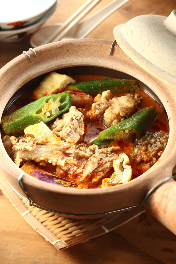Claypot curry fish head royalty free stock image