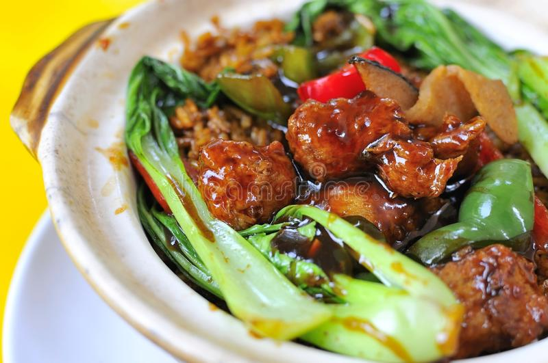Claypot sweet and sour pork meal royalty free stock photos