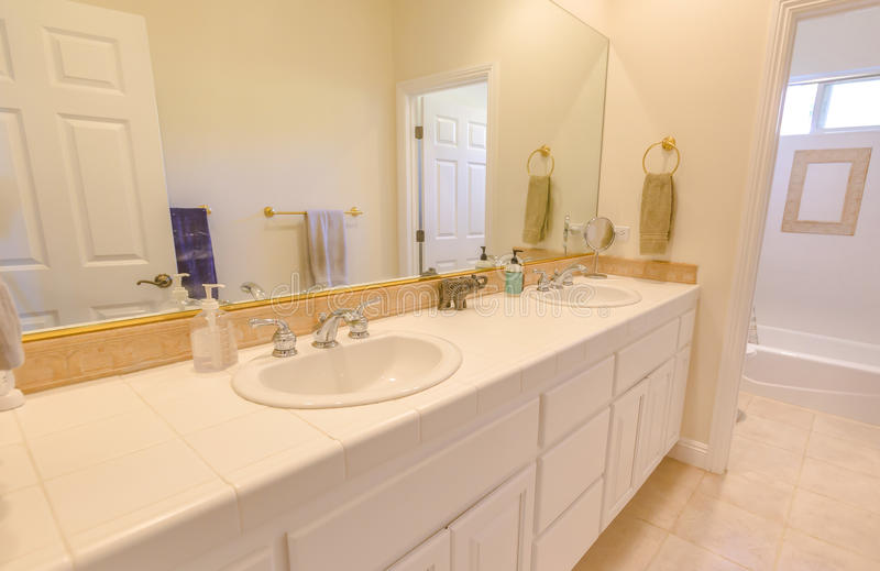 Clean bathroom with double sink in southern California. Model homes always show off beautiful bathrooms with clever design stock images