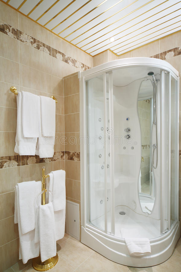 Clean Bathroom With Shower Cabin And Hangers Stock Photo - Image of ...