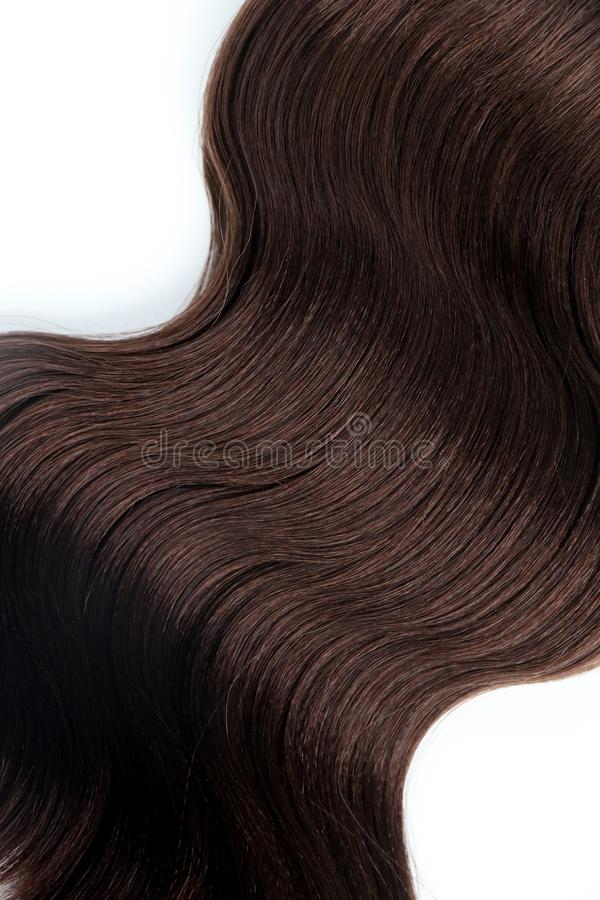 Wavy of brown hair cross a white background isolated stock image