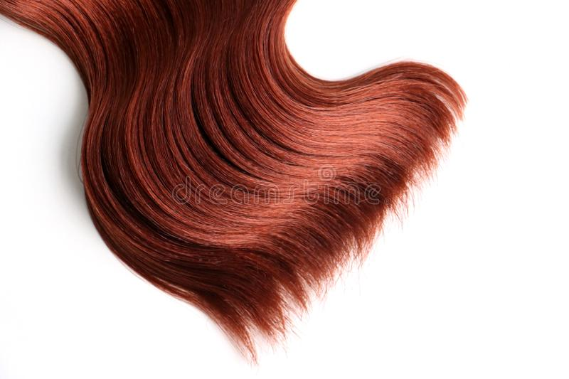 Wavy red hair on isolated white background stock image