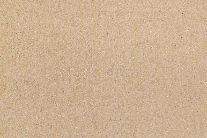 Clean cardboard texture with good details. Macro shot of unused clean cardboard. Light brown colored, textured background image. Empty cardboard surface royalty free stock photography