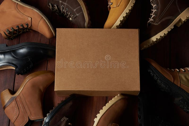 Clean cartoon shoe box. With leather shoes around top view royalty free stock images