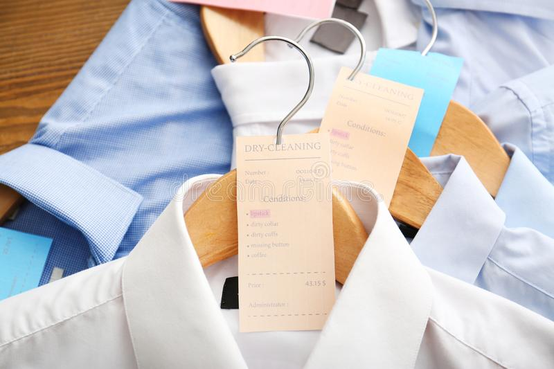 Clean clothes after dry-cleaning. On table royalty free stock photo