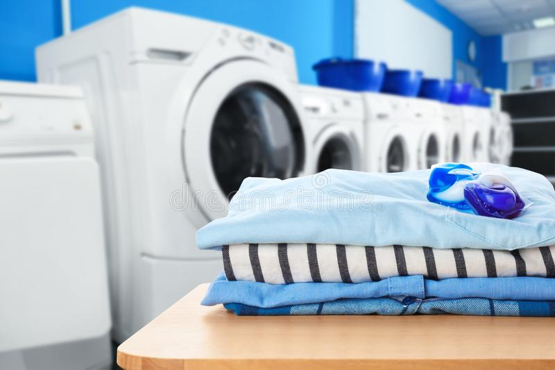 Clean clothes with gel pods. At self-service laundry royalty free stock images