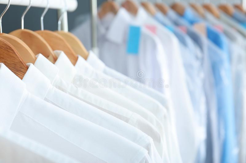 Clean clothes on hangers after dry-cleaning,. Closeup royalty free stock images