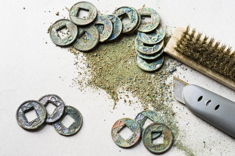 Clean The Coin Which Named Wuzhu Royalty Free Stock Photo