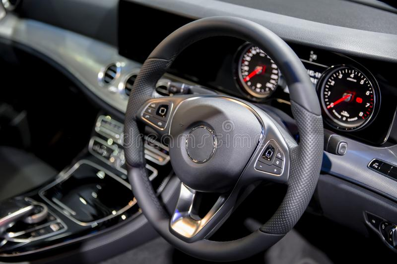 Clean console modern car interior black steering wheel royalty free stock image