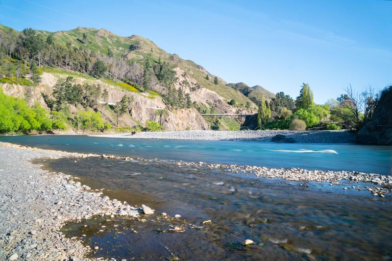 Clean cool fresh water of Waiau River. Clean cool fresh fast flowing water of Waiau River and stony river bed at Hanmer Springs, New Zealand royalty free stock image
