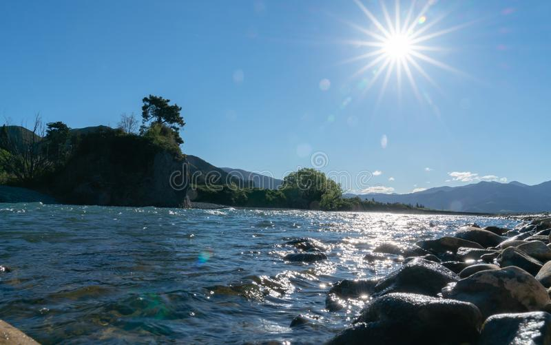 Clean cool fresh water of Waiau River. And stony river bed at Hanmer Springs, New Zealand stock photography