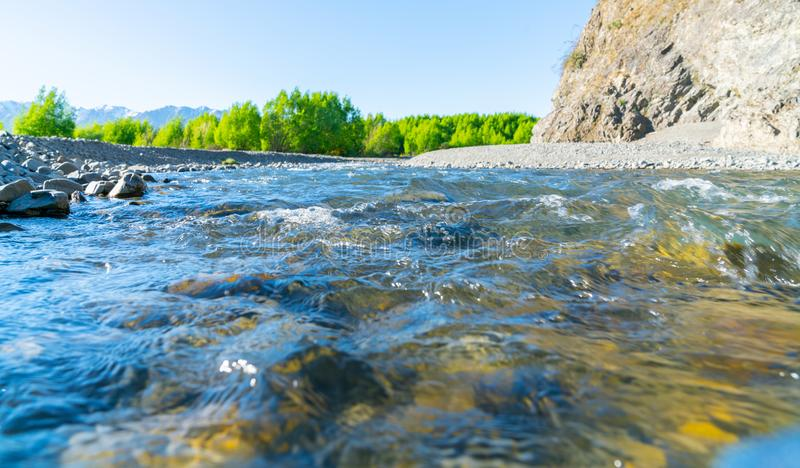 Clean cool fresh water of Waiau River. And stony river bed at Hanmer Springs, New Zealand stock images