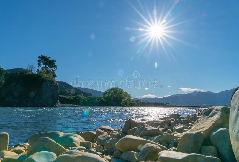 Clean cool fresh water of Waiau River. And stony river bed at Hanmer Springs, New Zealand royalty free stock photos
