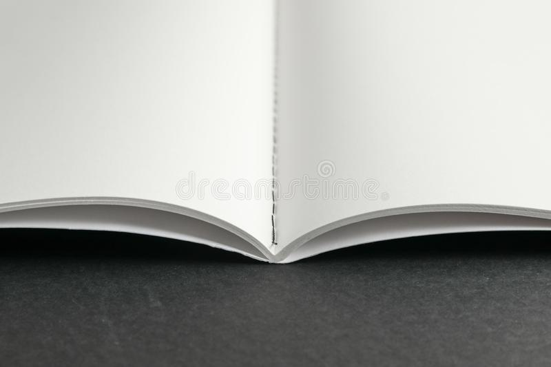 Clean copybook on black background. Space for text royalty free stock photos