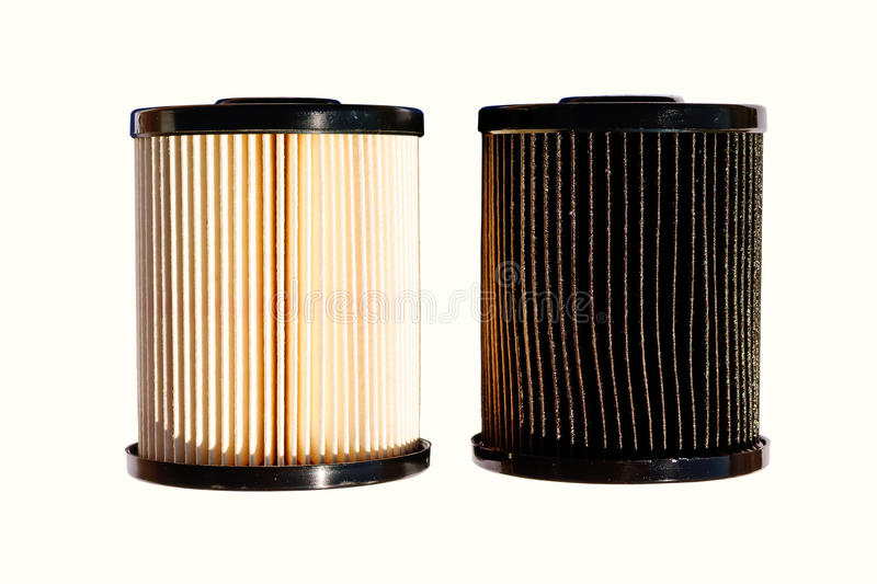 clean and dirty diesel fuel filters stock photo
