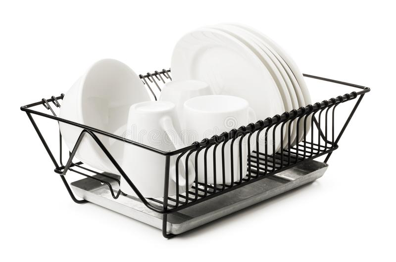 Clean dishes drying on metal dish rack royalty free stock image