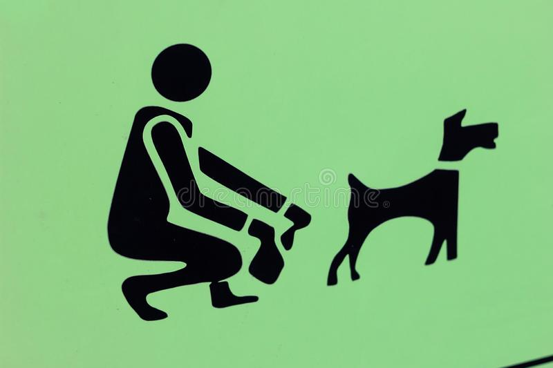 Clean the dog sign. pick bag garbage poo rule. prohibition green. Notice stock photos