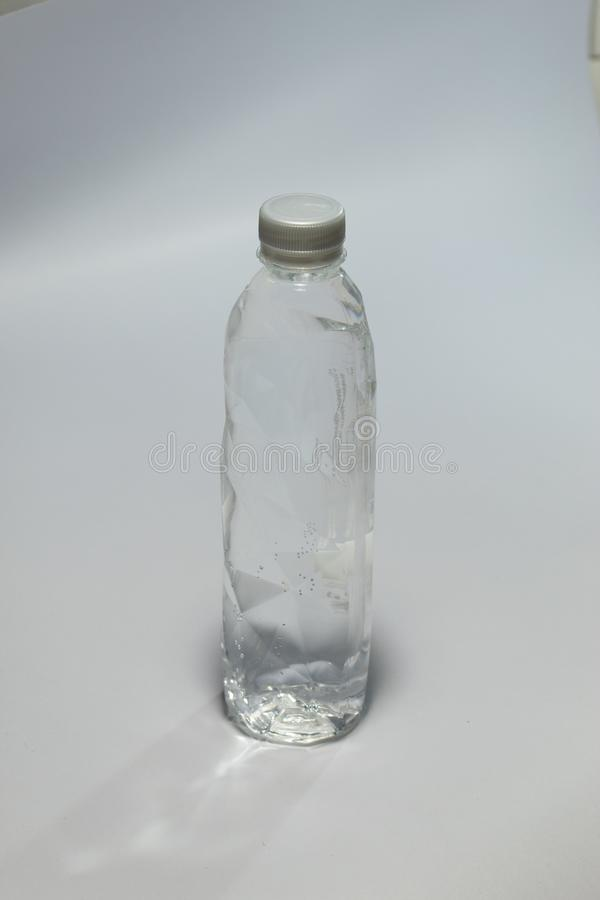 Clean drinking water packaged in clear plastic bottle. royalty free stock photography
