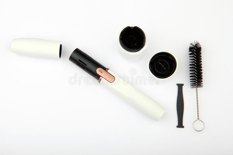 Clean electronic smoke device white background nobody. Studio quality royalty free stock photography