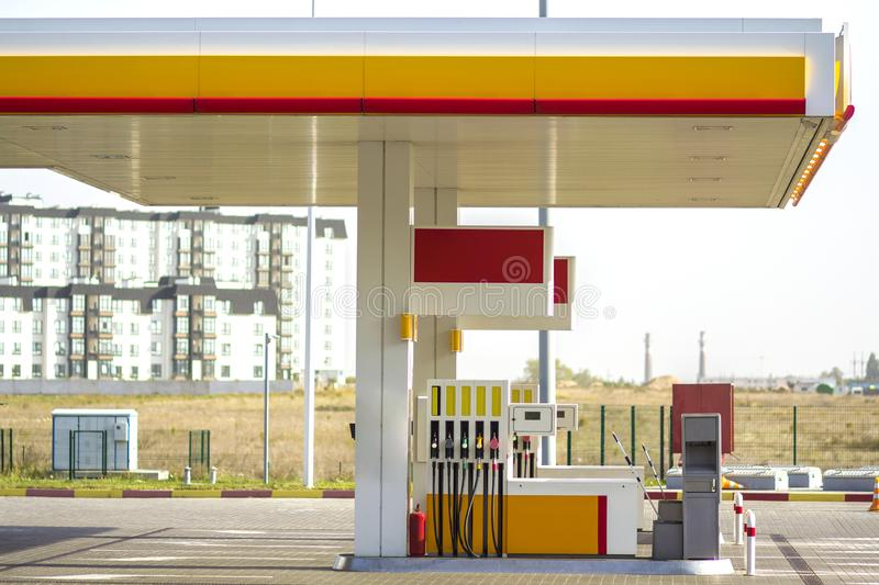 Clean empty auto gas station exterior on sunny day on rural landscape and bright sky copy space background stock photo